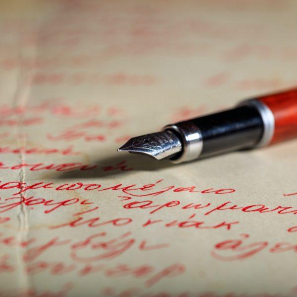 Ink pen on a handwritten letter